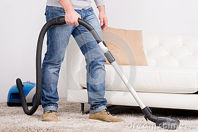 vacuum-cleaner-man-does-house-work-34414118
